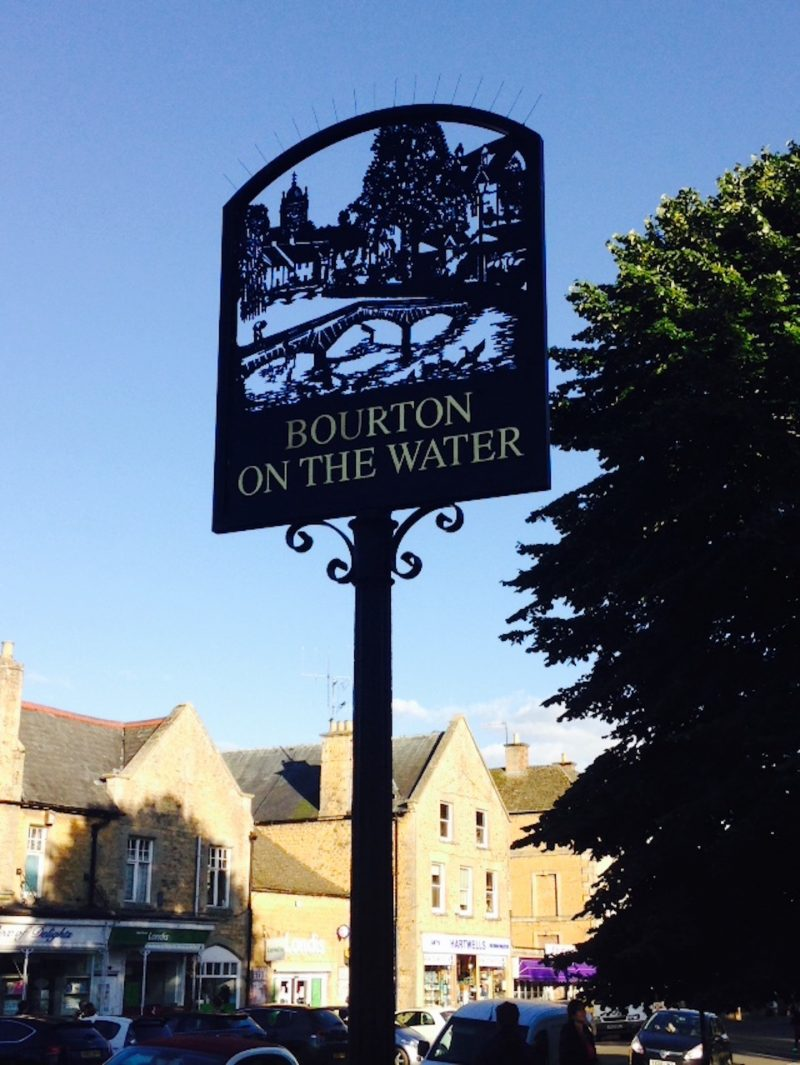 Bourton-on-the-Water in the Cotswolds on a summer evening.