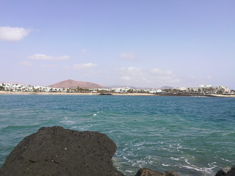 Volcano visible from shore on Costa Teguise, Lanzarote.