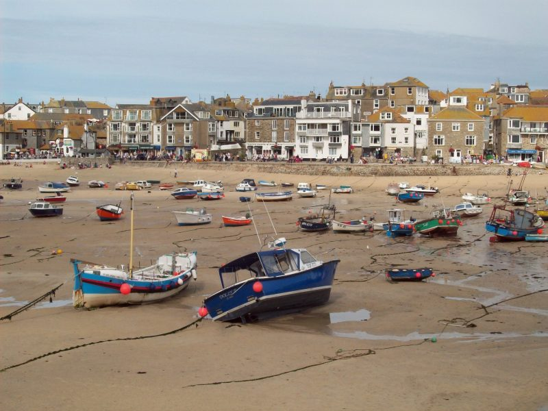 Boats at low tide in St Ives bay Cornwall