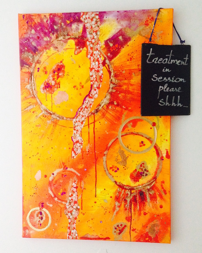 Yoga and art: orange abstract painting by Emerald Dunne at Evolve Wellness centre, London.