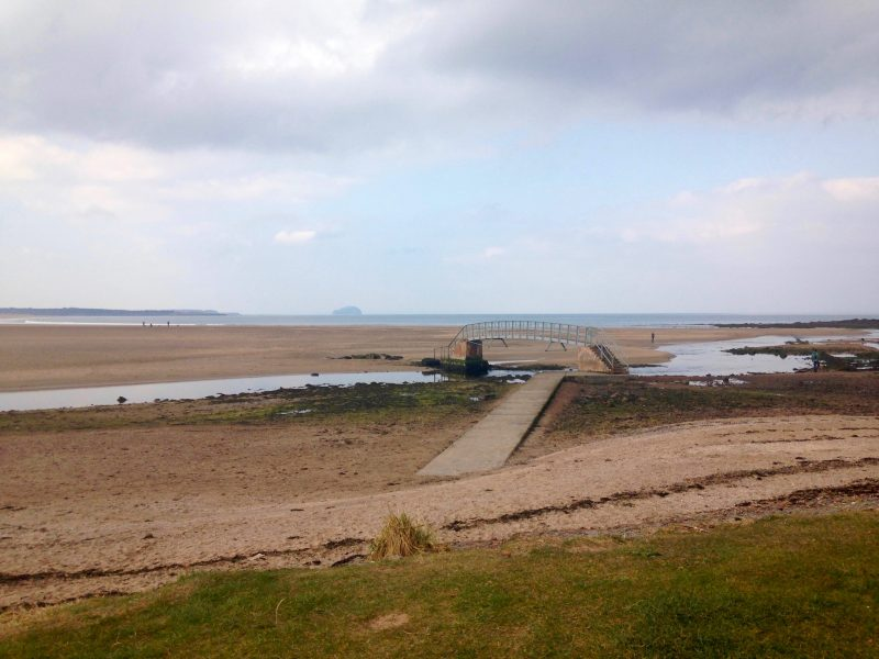 Turning 50: On Bellhaven beach with the bridge to nowhere near Dunbar.
