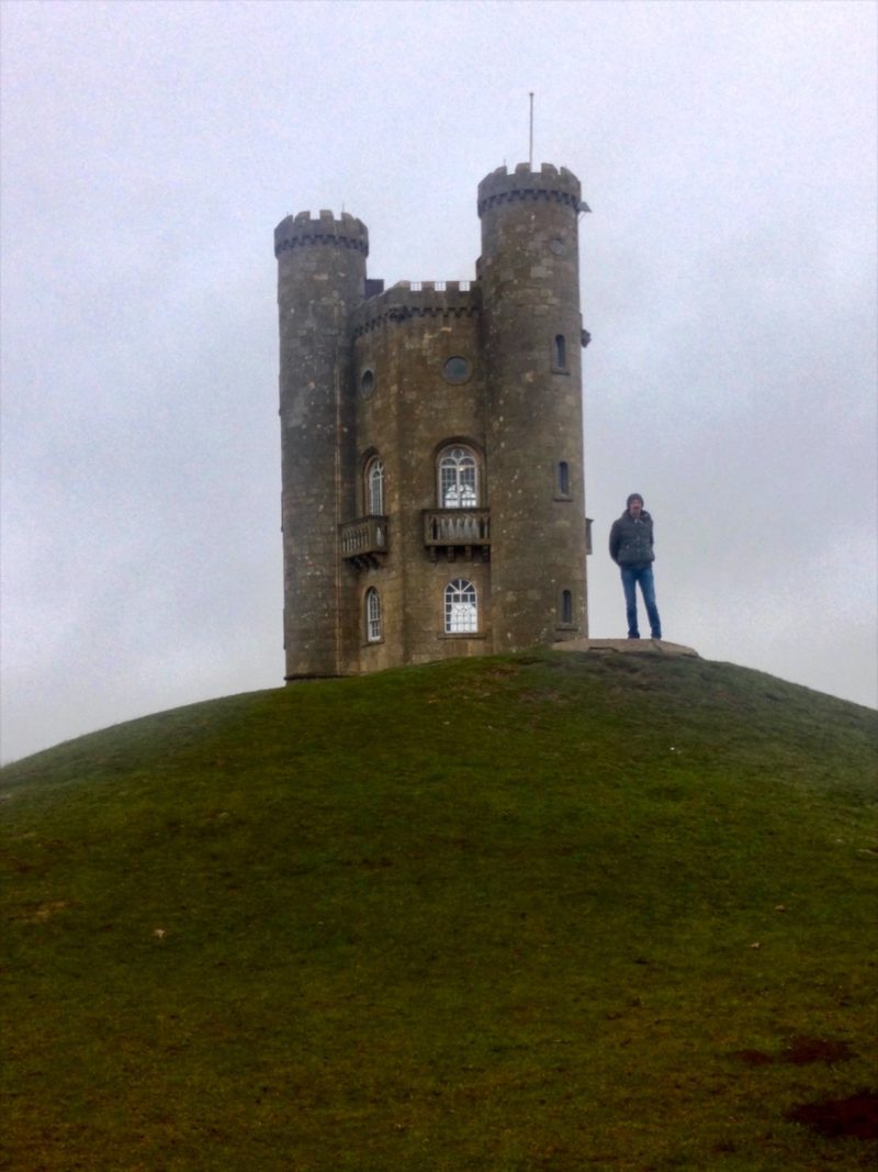 Standing beside Broadway Tower, Cotswolds.