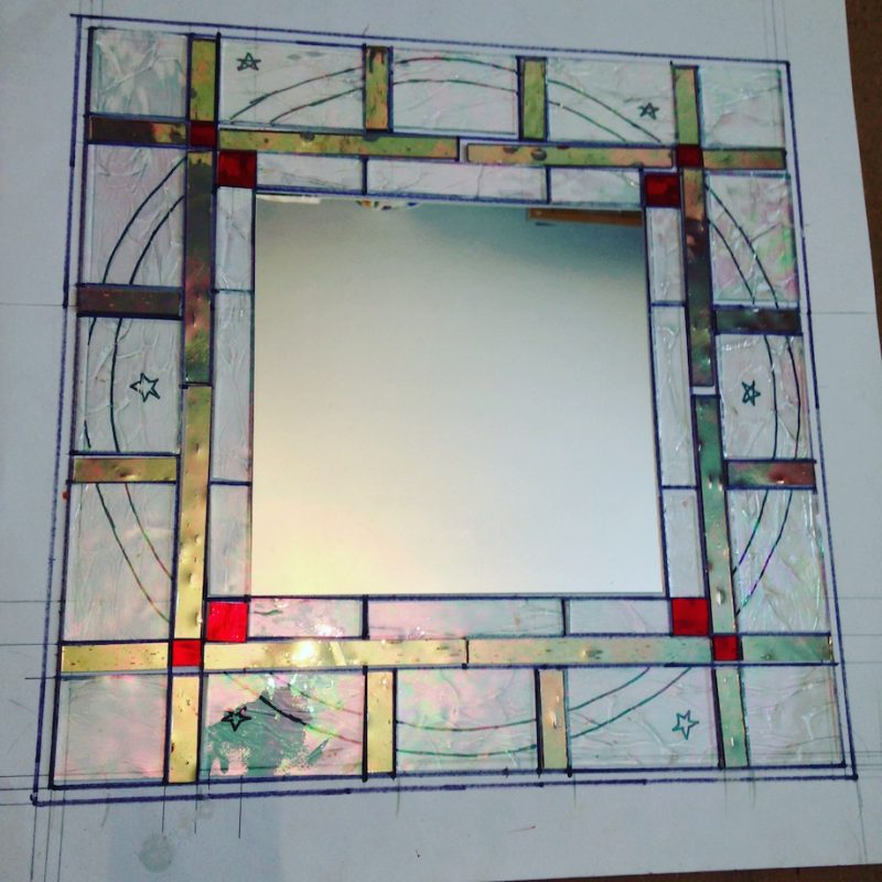 Handmade mirrors with coloured glass and sandblasted pattern around the edge. Work-in-progress.