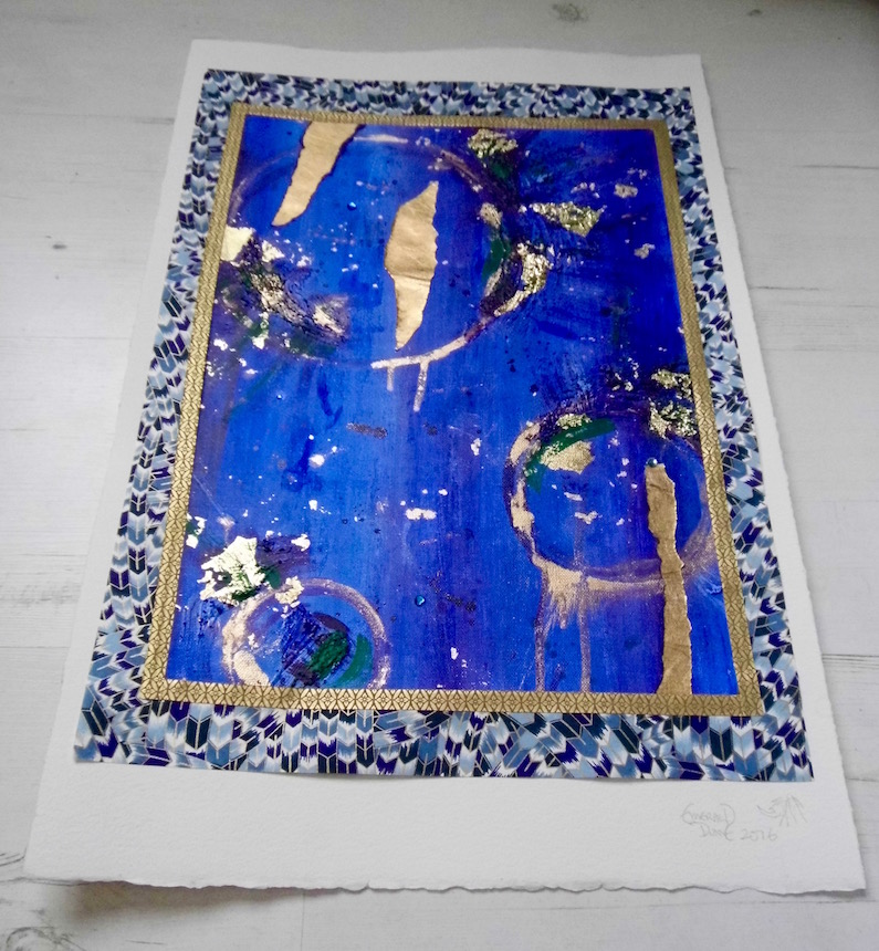 Abstract blue paintings by Emerald Dunne Art: Blue and gold piece in chiyogami paper frame.