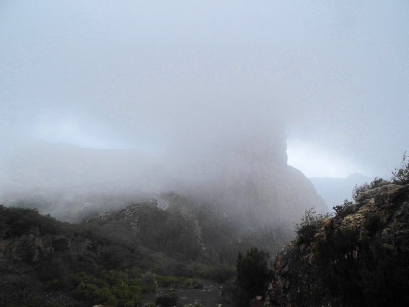 Misty volcano with disappearing road on la Gomera, Canary Islands.