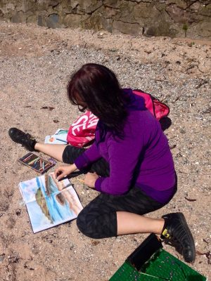 Artist date on Millport island, May 2018: Emerald Dunne Art sketching on the beach.