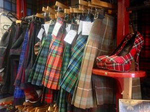 Kilts and tartan shoes at Armstrongs, vintage clothing store in the Grassmarket, Edinburgh.