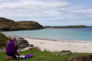 May 2018: Emerald Dunne Art, Glasgow artist, sketching on Bernera beach on the Isle of lewis, Outer Hebrides, Scotland. Surely the most beautiful beaches in the world!
