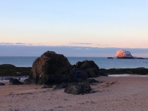 Bass Rock from North Berwick beach at midsummer.