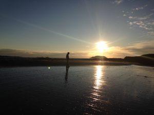 Stephen Scott, Glasgow artist, sketching on North Berwick beach at midsummer.
