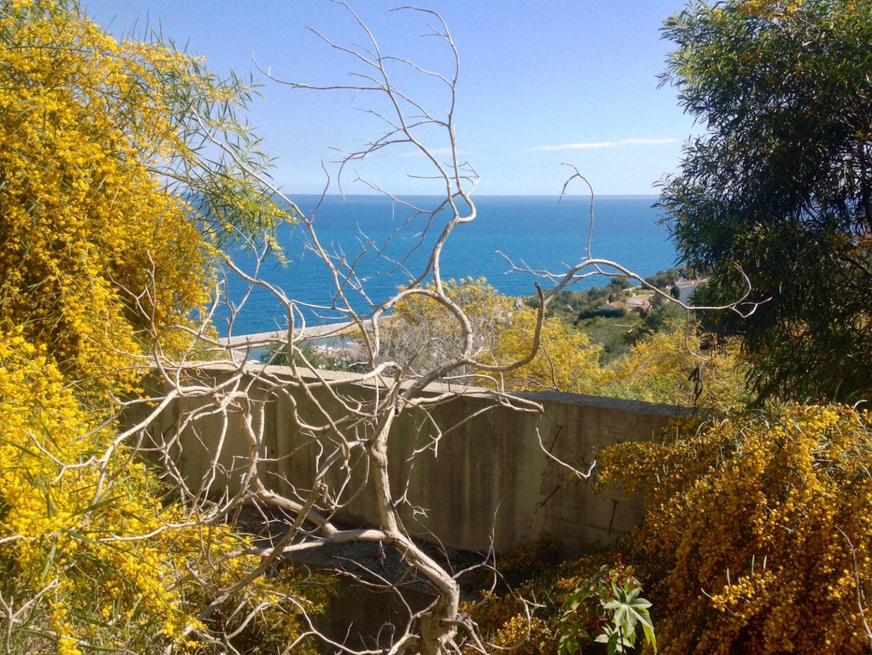 Walk to Almunecar along cliffs and beach from La Herradura in Spain.