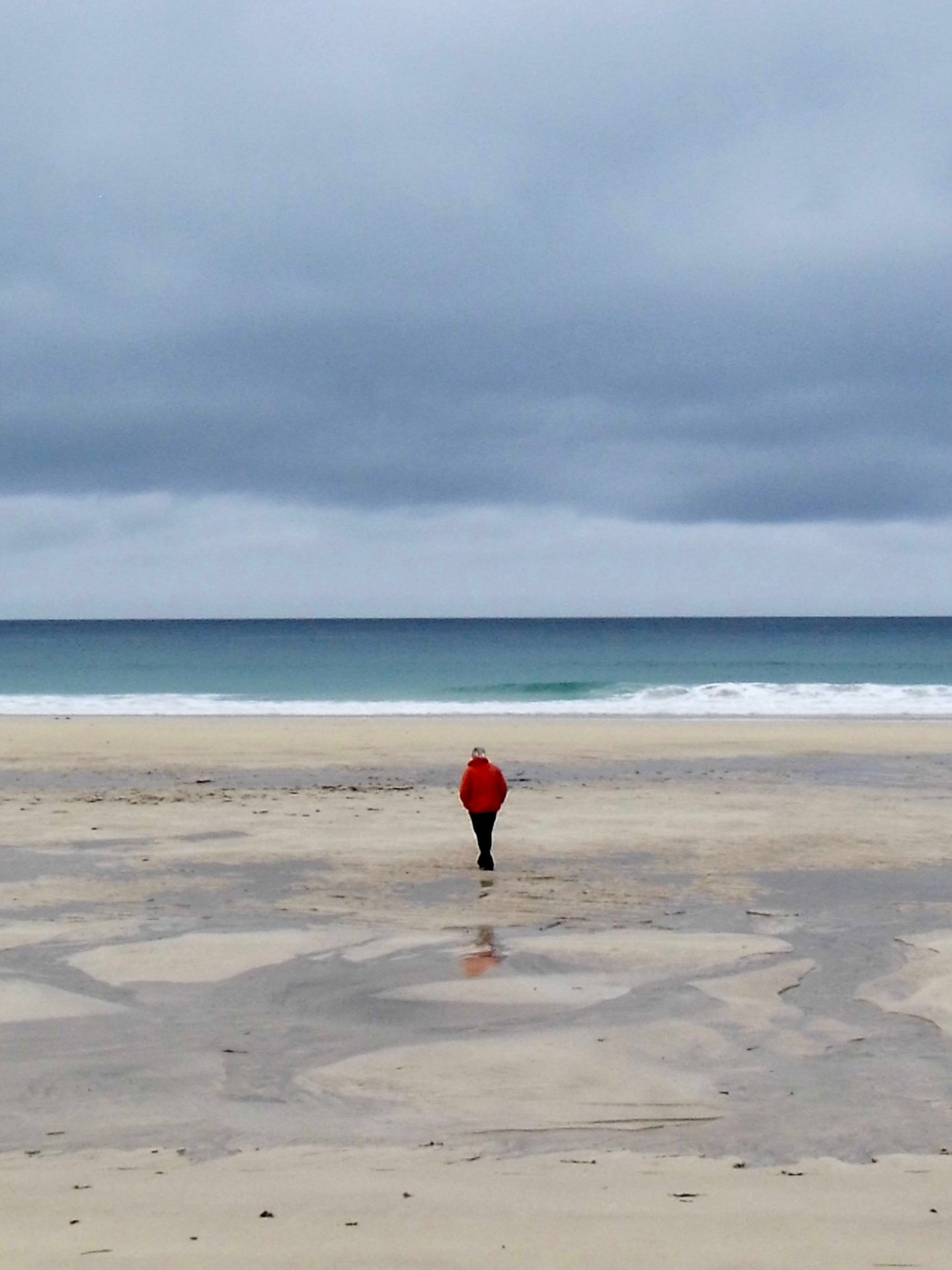 Social distancing: Man alone on wide beach, Isle of Lewis, Scotland.
