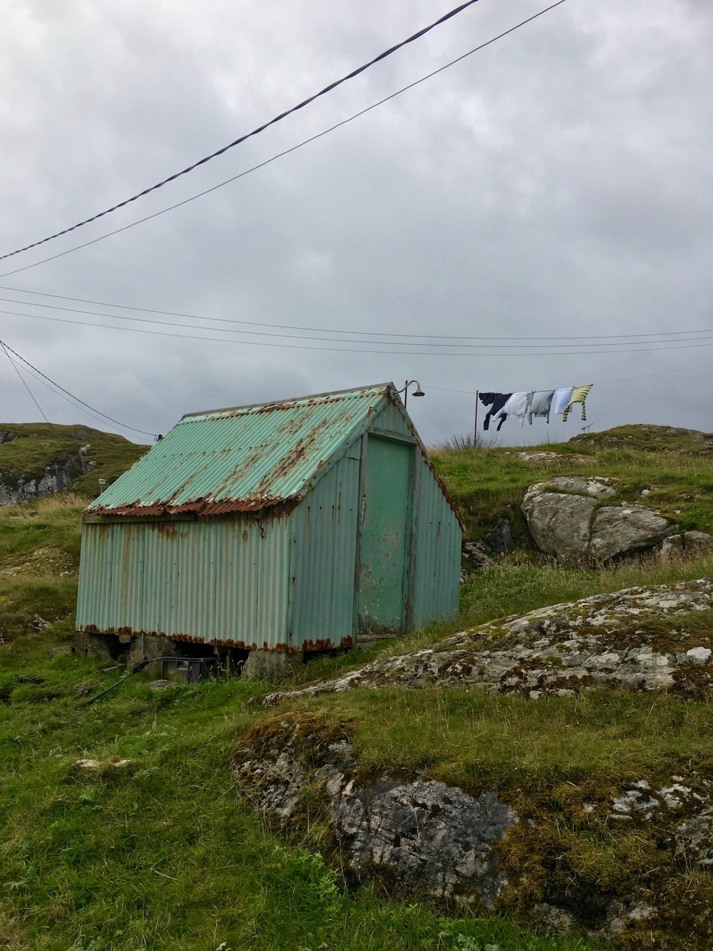 green shack and washing line on the Golden Road, Isle of Harris